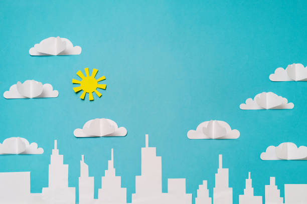 City skyline with paper cut clouds and sun. Craft paper objects photography for banners/landing pages/backgrounds design with copy space. stock photo