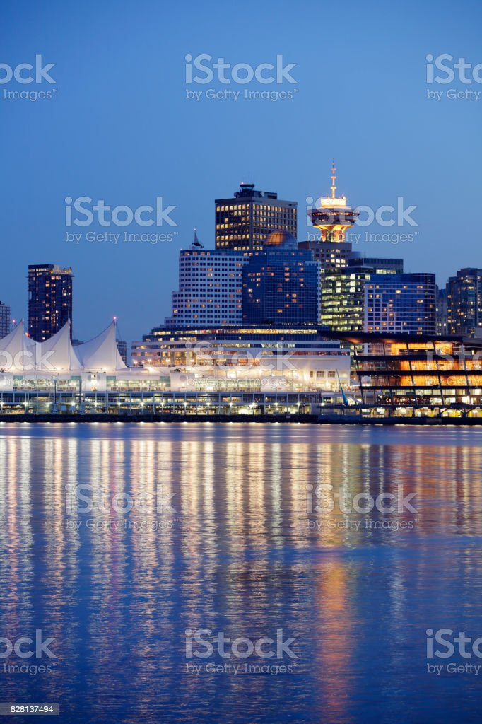 City skyscrapers at night in Vancouver overlooking water stock photo