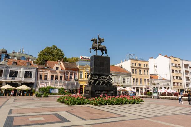 City square with the big monument and old retro buildings in downtown Nis, Serbia - August 28, 2019: City square with the big monument and old retro buildings in downtown on a sunny summer clear day in the city of Nis, Serbia, Europe serbia stock pictures, royalty-free photos & images