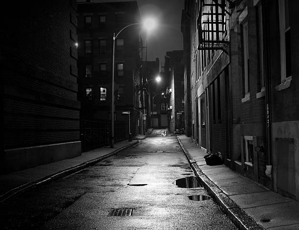 City Street in Black and White Dark street in the North End section of Boston, Massachusetts alley stock pictures, royalty-free photos & images