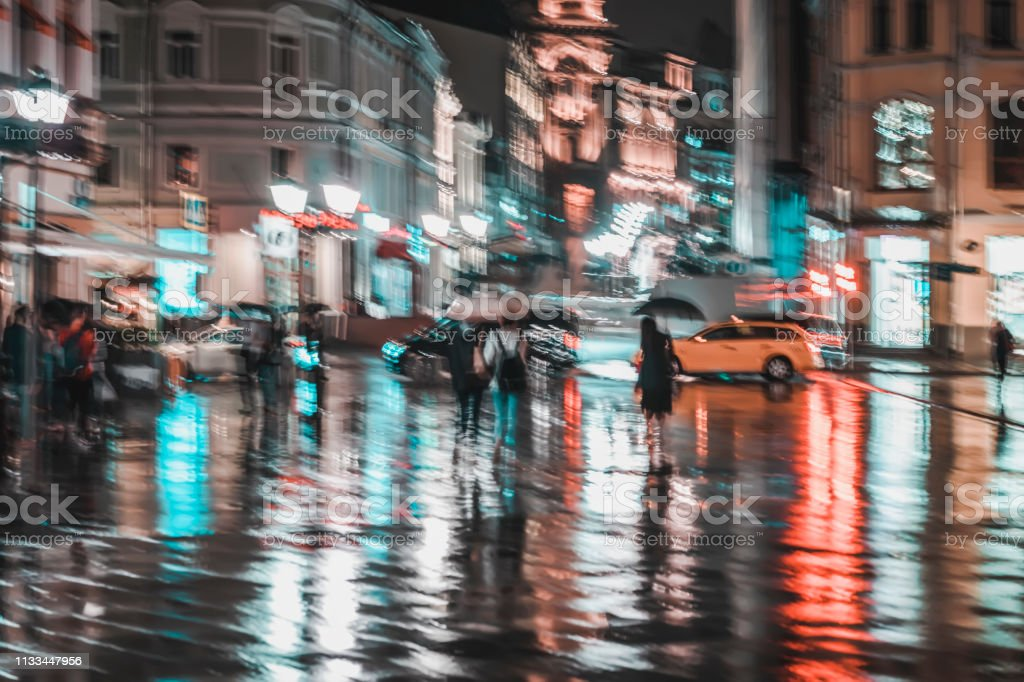 City street in rainy night, Abstract bright blurred background with...