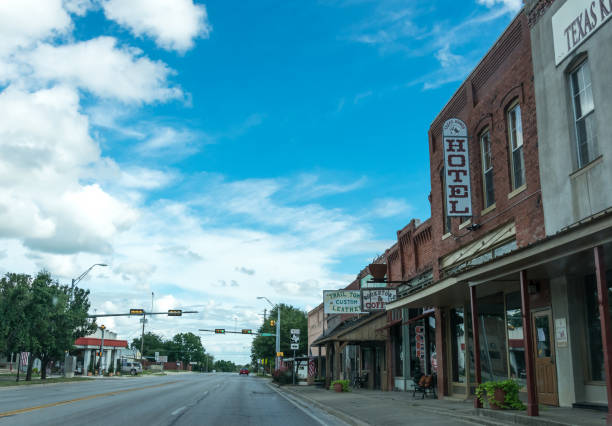 city street in the town of clarksville in texas. provincial life in the usa - western town stock photos and pictures