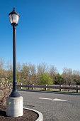 city street light at a parking lot in suburb area