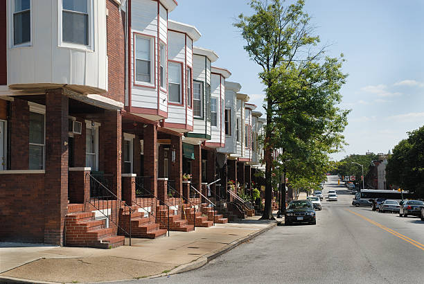 City Street lined with Row Houses and Trees stock photo