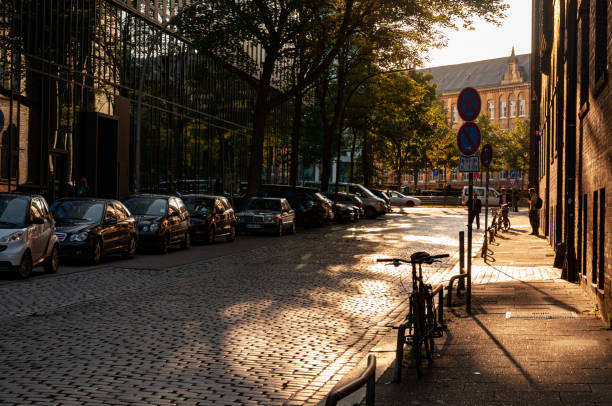 City street of Hamburg. Old road and corporate buildings stock photo