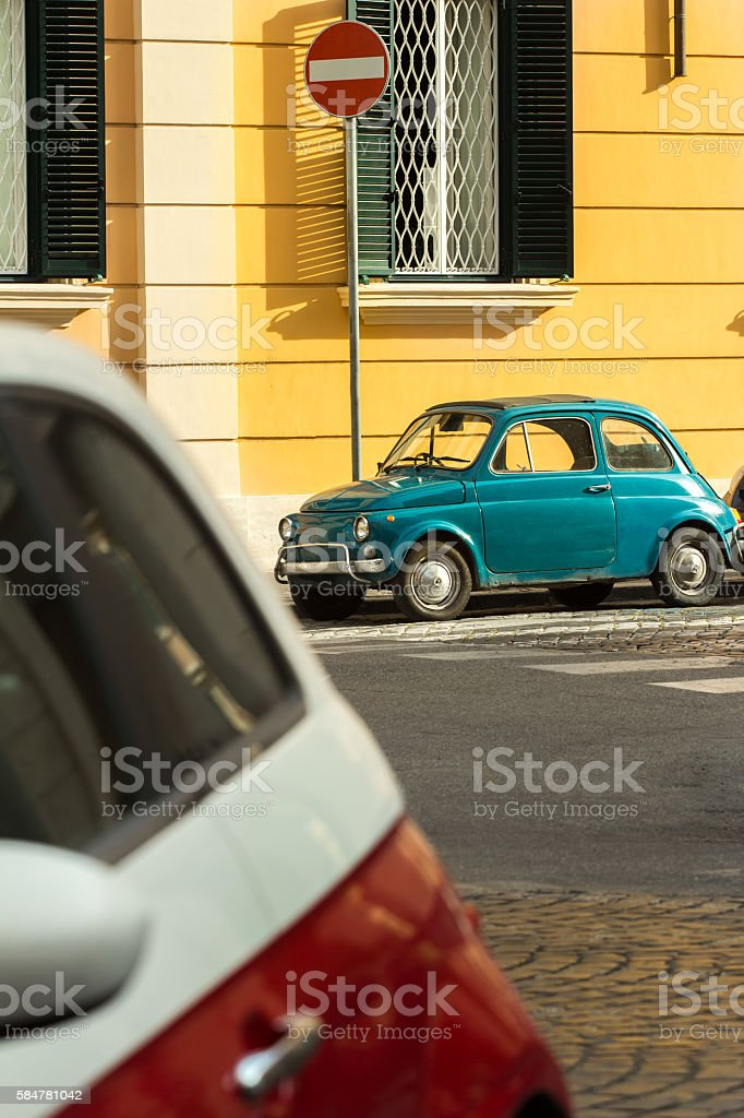 City street with classic vintage cars parking stock photo
