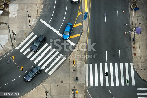 istock City street with crosswalks on asphalt road and car traffic 660563180