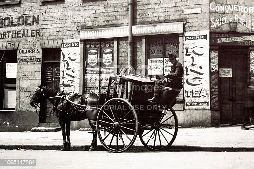 Sydney, Australia - 1924: Detail of old photo from 1924 of horse carriage with rider standing on street of Sydney Australia