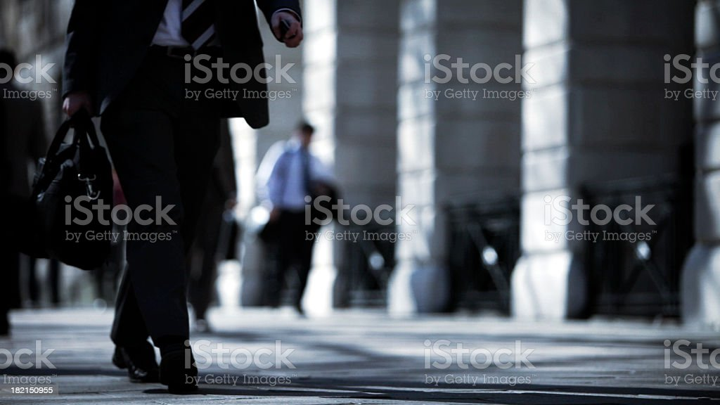 City street with professional people walking stock photo