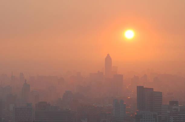 City Sunset in Smog stock photo