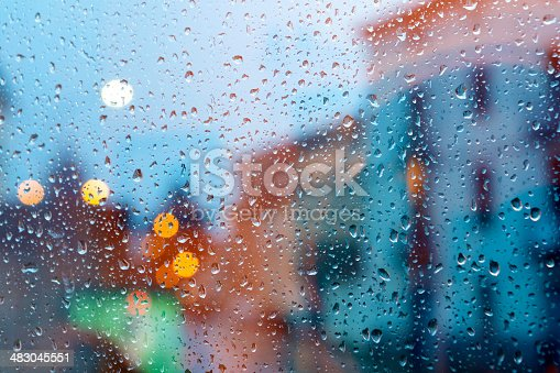 storm in the city through wet window.Home related