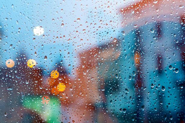City through wet window stock photo