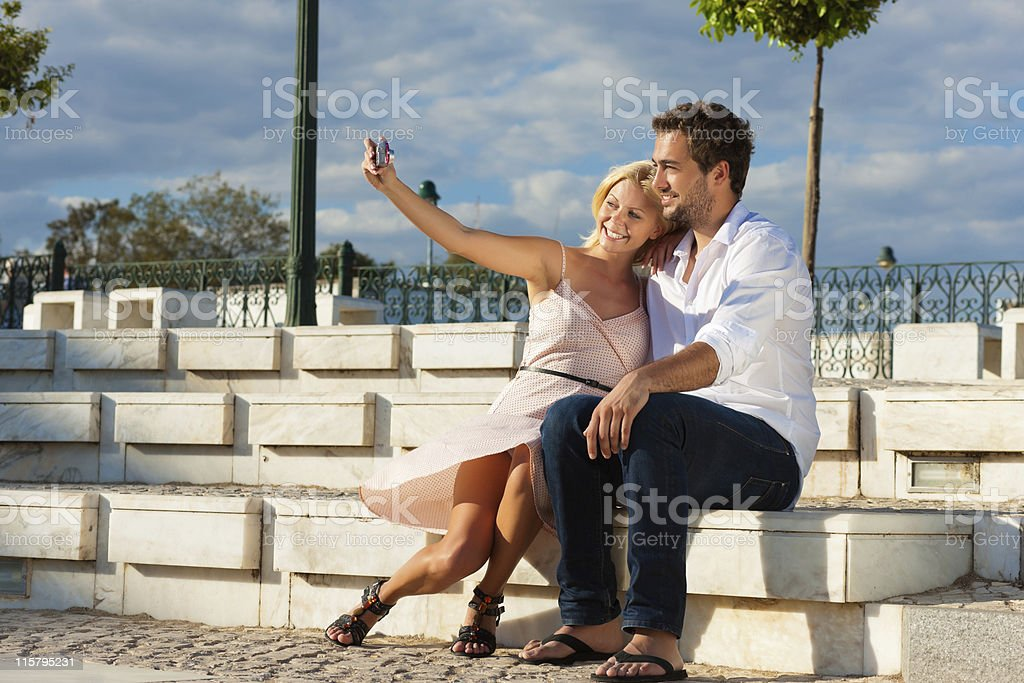 City tourism - couple in vacation on a bench stock photo