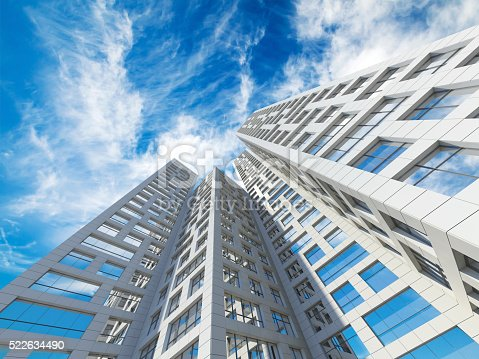 585292106 istock photo City towers under blue cloudy sky. 3d 522634490