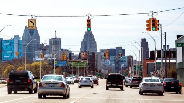City traffic - Detroit, Michigan Streets of Detroit, Gratiot Avenue. detroit michigan stock pictures, royalty-free photos & images
