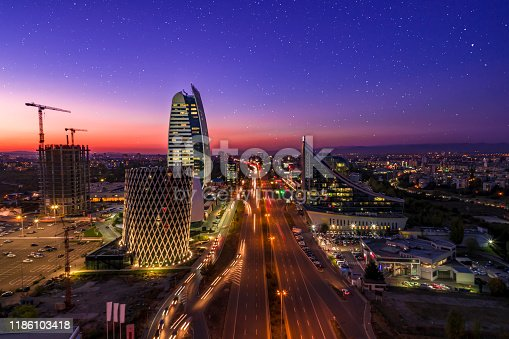 City traffic long exposure corporate night aerial view drone shot of financial business district in Sofia, Bulgaira at sunset. The scene is situated at dusk (sunset) in a corporate financial district of Sofia, Bulgaria (Eastern Europe). The picture is taken with DJI Phantom 4 Pro drone.