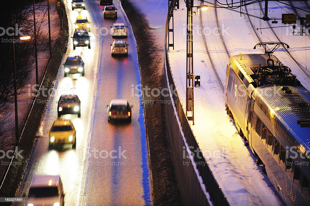 City traffic, trains and cars by winter night royalty-free stock photo