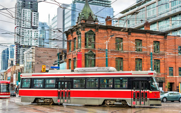 city tram in toronto, queen st west - spadina ave - toronto streetcar stock photos and pictures