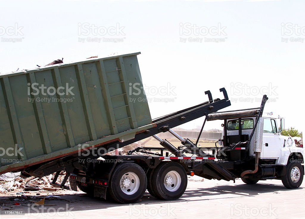 City truck unloading dumpster of trash stock photo