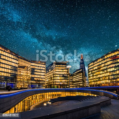 Blocks of offices at night in London, England, under the Milky Way.