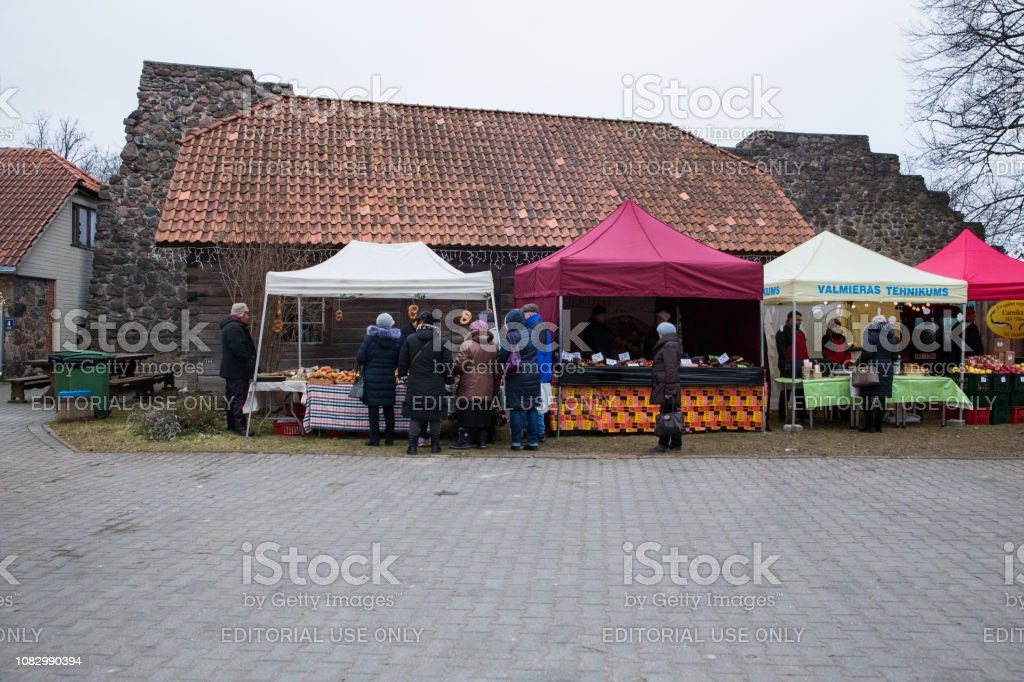 City Valmiera, Latvia. City street markets, buildings and peoples....