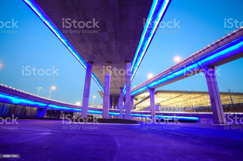 city viaduct bridge of neon lights night stock photo