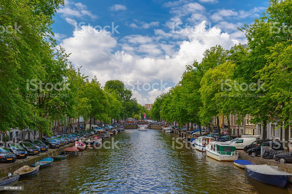 City view of Amsterdam canal with boats, Holland, Netherlands. stock photo