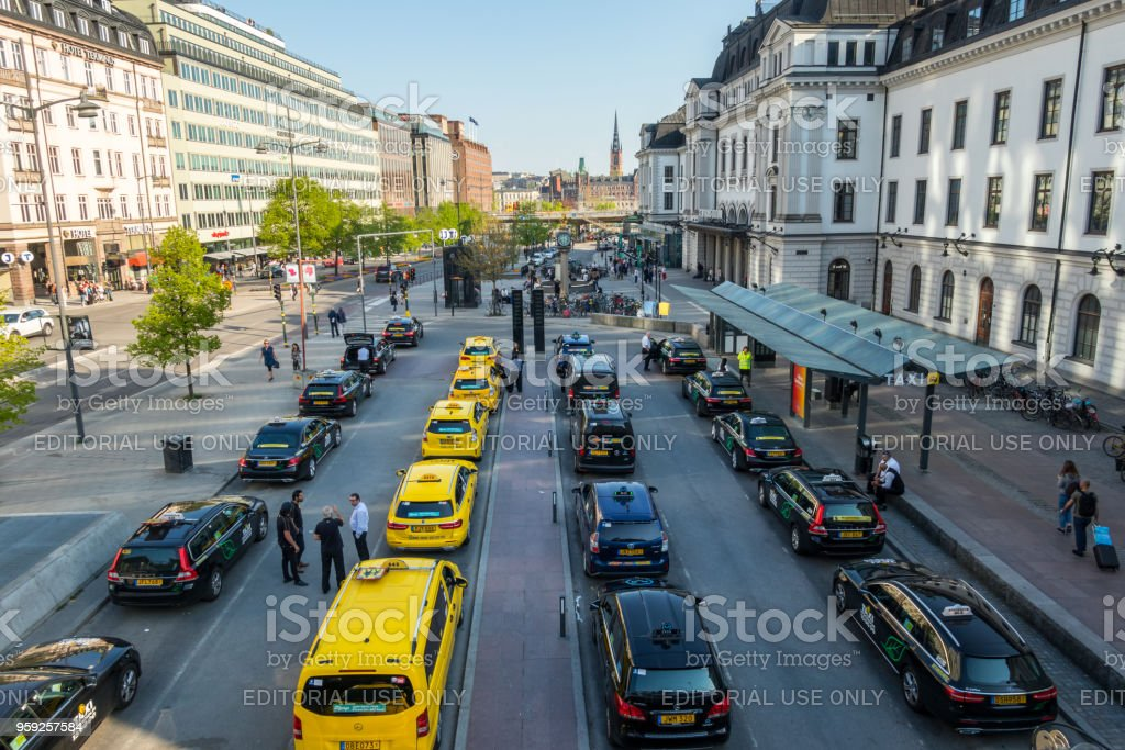 City view of many yellow and black taxis in line. stock photo