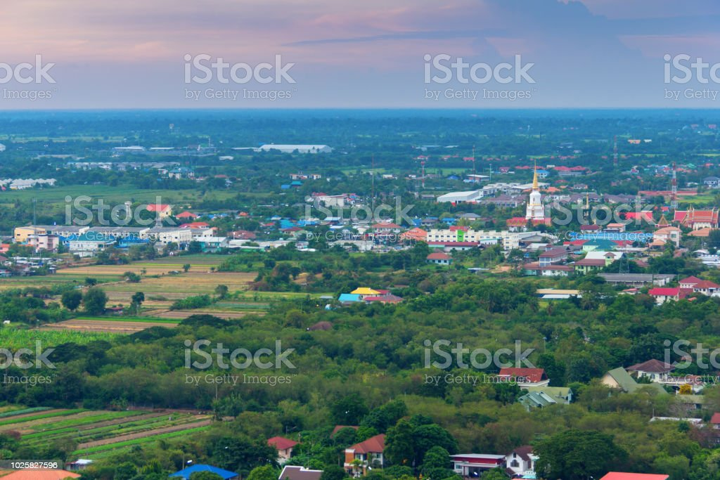 city view on evening time with temple and green natural stock photo