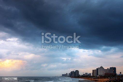 City skyline under storm clouds. Tel Aviv, Israel