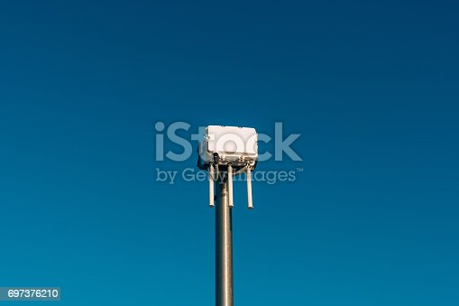 istock City wifi router. The street transmitter of the Internet signal 697376210