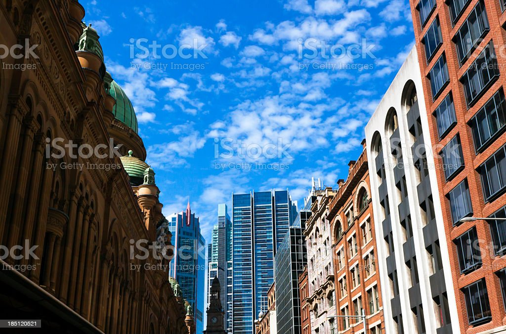 City with old and new office buildings against blue sky royalty-free stock photo