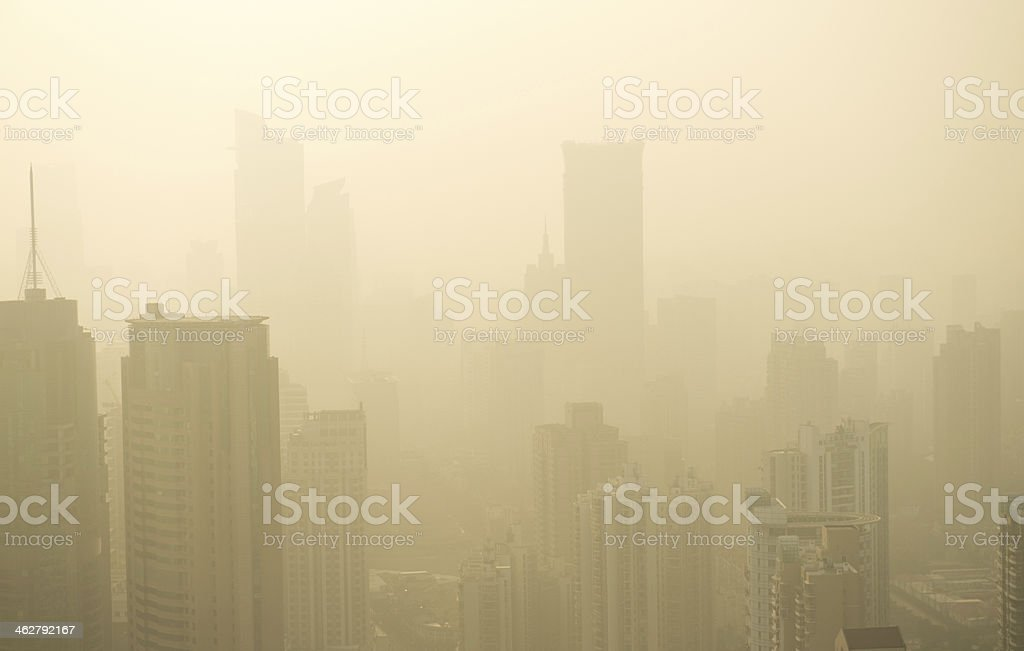 A city with skyscrapers in the fog stock photo
