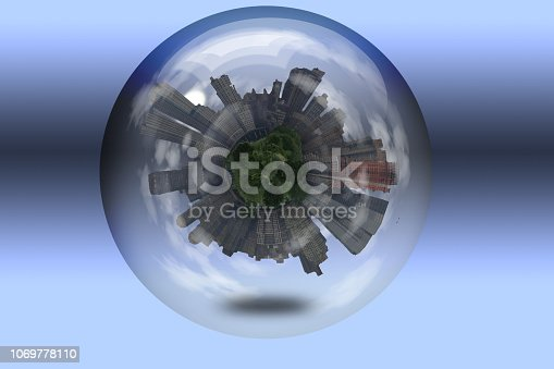 City with tree tops in crystal ball