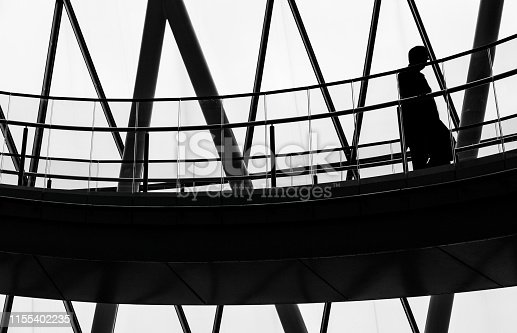 180698194 istock photo City Worker Walking Down Staircase and Modern Futuristic Architecture 1155402235
