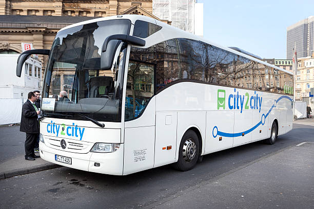 City2City bus Frankfurt, Germany - January 30, 2014: City2City bus in the city center of Frankfurt, waiting for passengers. City2City is an intercity coach operator providing services in Germany, it is run by National Express Germany GmbH deregulation stock pictures, royalty-free photos & images