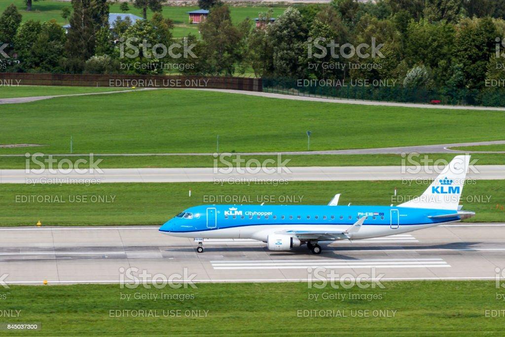 ZURICH 2017/09/08 KLM Cityhopper Embraer ERJ-175STD ready to depart on runway 28 at Zurich Airport stock photo