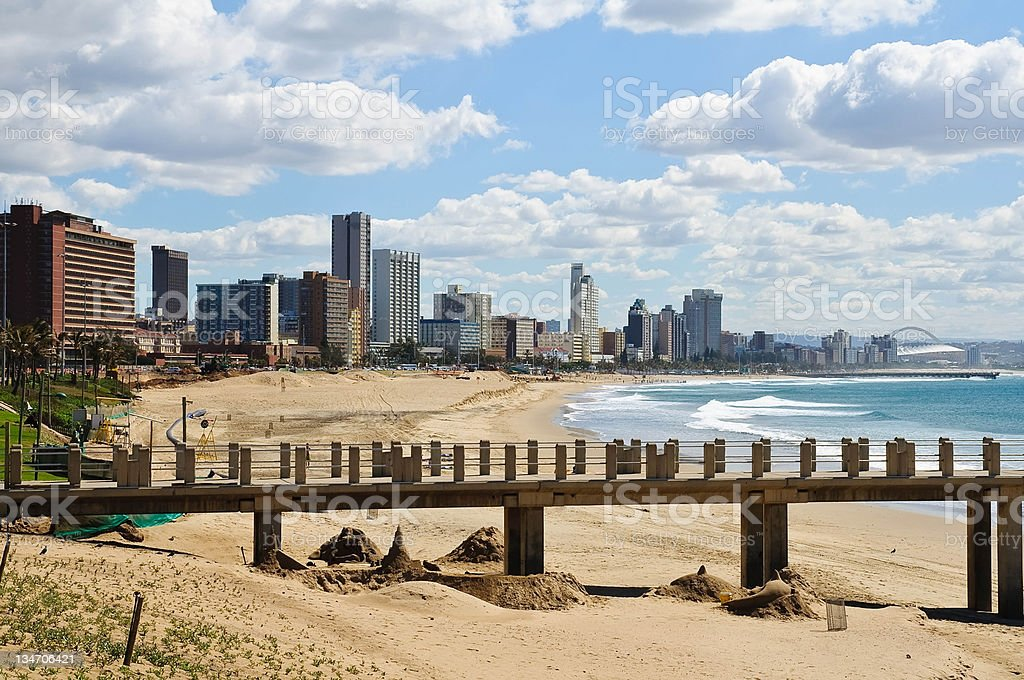 Cityscape and beach of Durban - South Africa Durban is the third most populous city in South Africa, forming part of the eThekwini metropolitan municipality. It is a major centre of tourism due to the city's warm subtropical climate and beaches. Africa Stock Photo