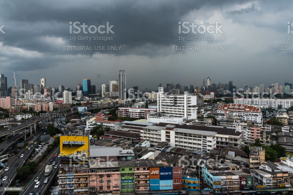 Cityscape and building of city in storm clouds sky from skyscraper stock photo