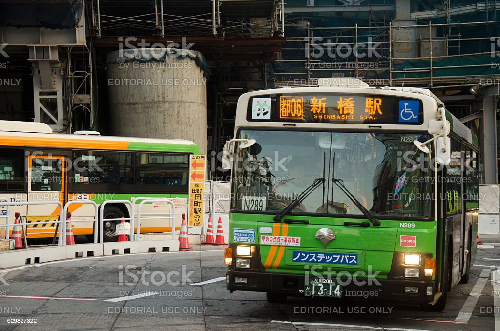 Cityscape and japanese people drive bus on traffic road stock photo