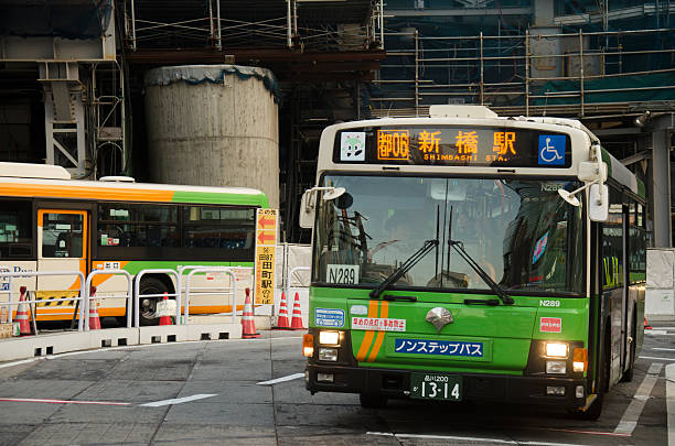 cityscape and japanese people drive bus on traffic road - バス ストックフォトと画像