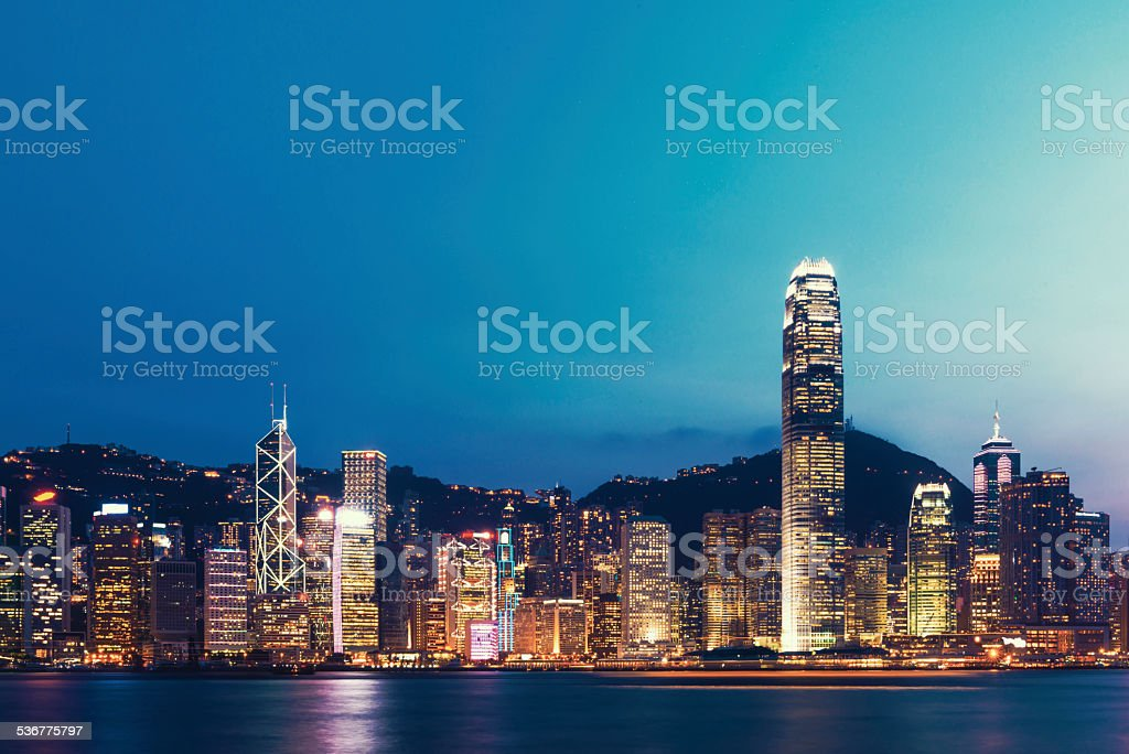 cityscape and office buildings of modern city hongkong at night stock photo