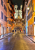 istock cityscape and old colorful architecture night view on Rome Spanish steps square, Italy 1077649566