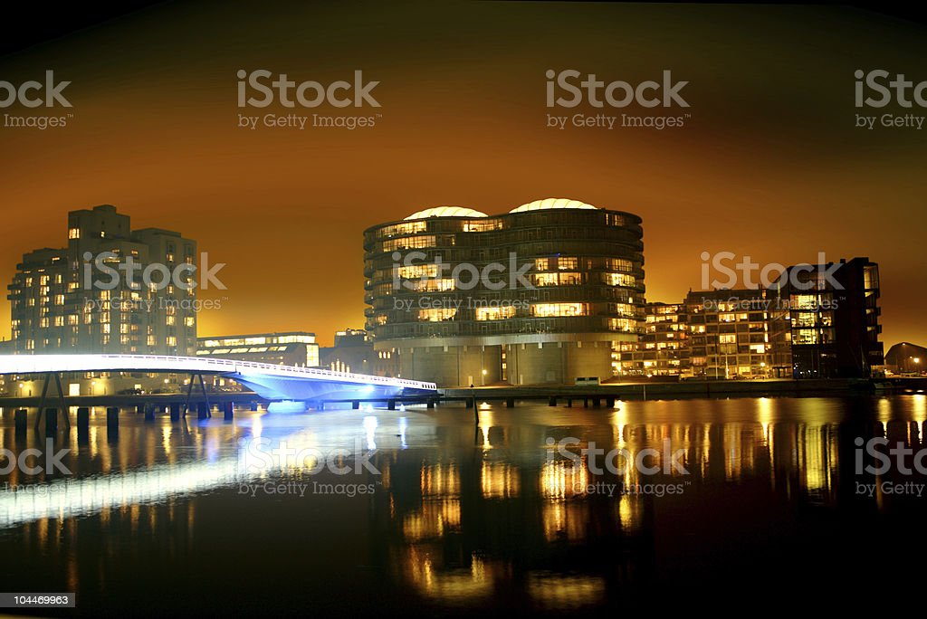 Cityscape and reflection in the water at night royalty-free stock photo