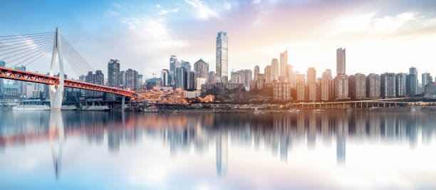 cityscape and skyline of chongqing in cloud sky cityscape and skyline of chongqing in cloud sky riverbank stock pictures, royalty-free photos & images