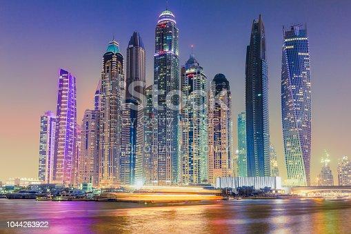 Dubai,UAE - October 5 2017: Amazing vibrant cityscape and skyline of Dubai. Development, skyline, skyscrapers in Dubai marina. high rise buildings, progress in UAE. Apartments and offices. Reflection