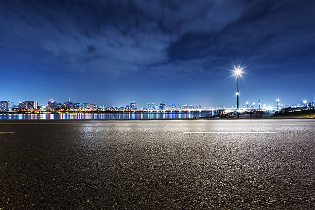 cityscape and skyline of modern city at night from road stock photo