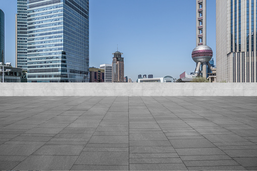 693903950 istock photo cityscape and skyline of shanghai from empty brick floor 1068988062