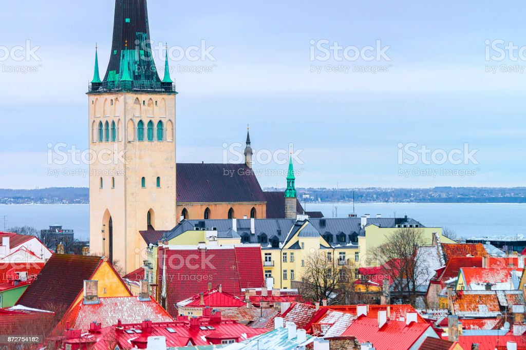 Cityscape and St Olaf Church in Old town of Tallinn stock photo