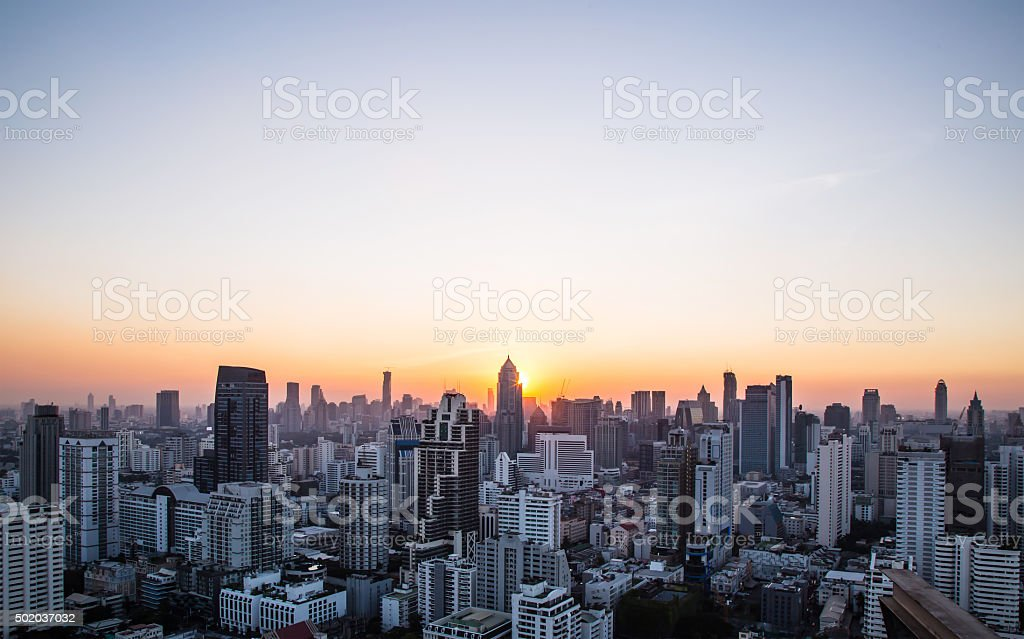 Cityscape and sunset at evening time stock photo